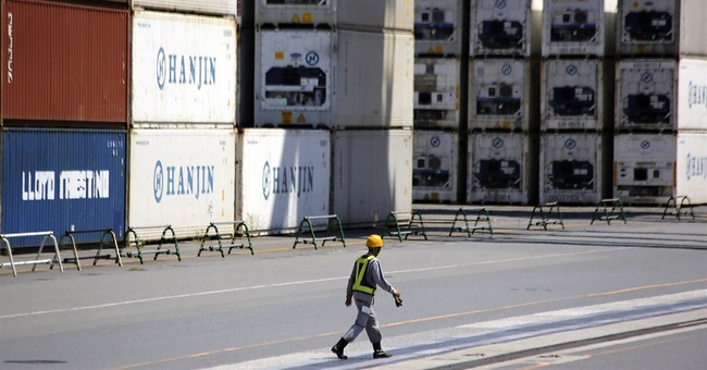 Japan trade deficit widens, exports up slightly