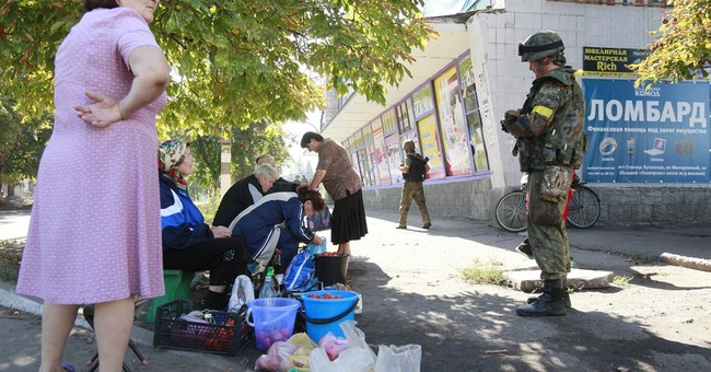 Russian aid convoy advances toward Ukraine