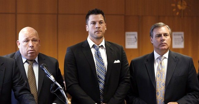 Judge drops rape charge against ex-Tigers pitcher