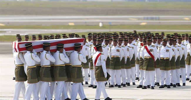 Malaysia receives bodies from Flight 17 crash