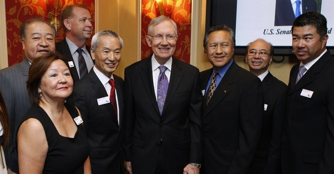 Reid apologizes for jokes at Asian business event