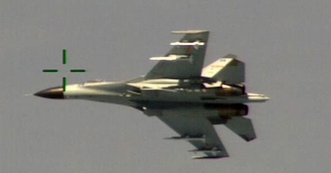 China defends intercepting US Navy plane