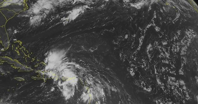 Storms dump heavy rain across northern Caribbean