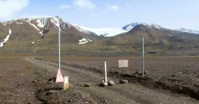 Iceland lowers aviation alert level from volcano