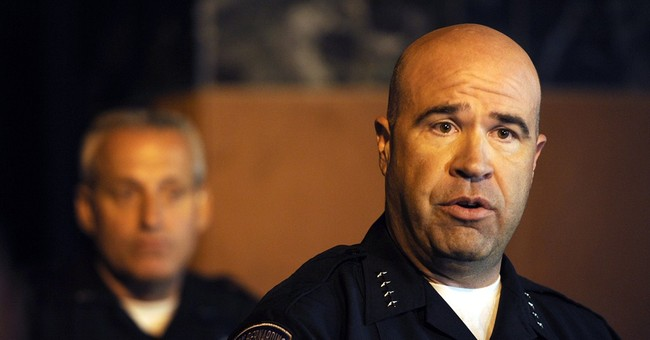 Officer critical in coma after California gunfight