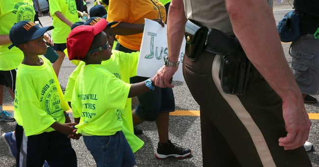 Protesters, police march peacefully in Ferguson