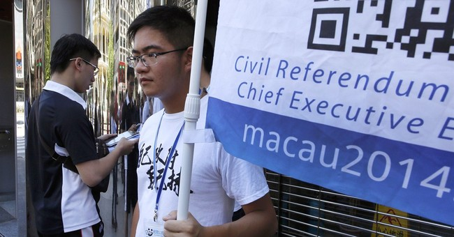 Macau police arrest 5 over informal democracy poll