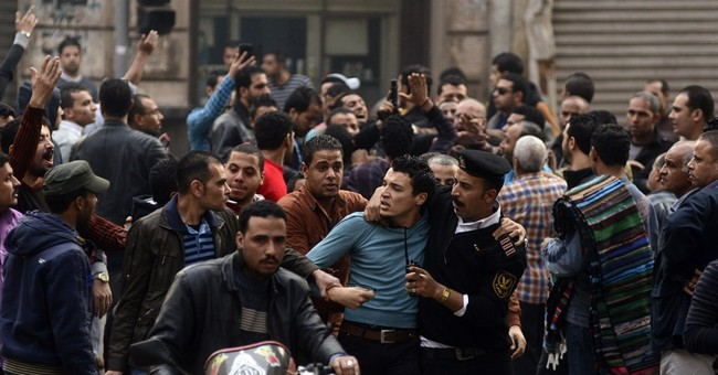 AP PHOTOS: Rage and celebration on Egypt's streets