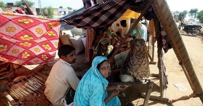 Raging floods kill over 440 in Pakistan, India