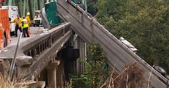 Crash sends truck dangling over Oregon bridge rail