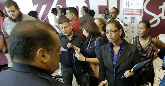 Applications for US jobless benefits fall sharply