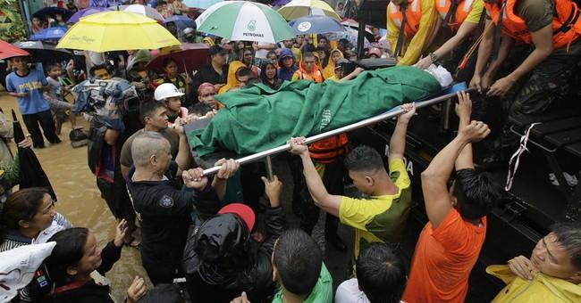 Floods shut down Philippine capital, 3 killed