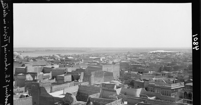AP Photos: Scenes from Iraq's Mosul then and now