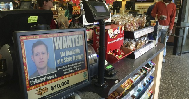 Tense hunt in trooper ambush case hits 8 days