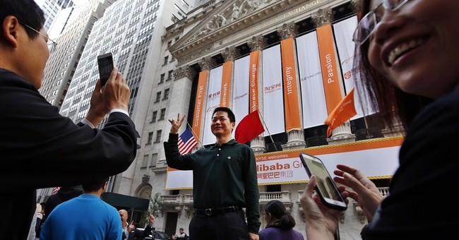 Alibaba stock soars in jubilant trading debut