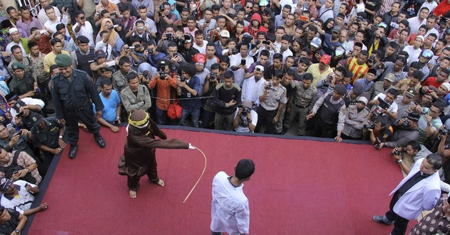 8 gamblers caned in Indonesia's Aceh province