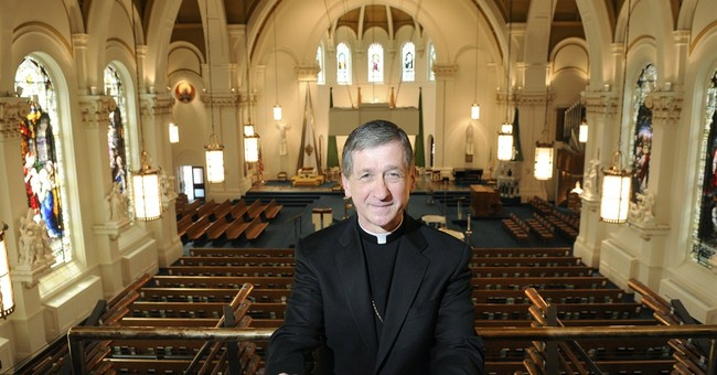 Pope chooses a moderate for Chicago archbishop
