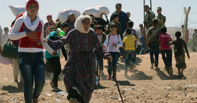 Kurdish fighters head to Syria to face militants