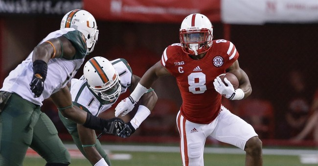 Abdullah key in No. 24 Neb's 41-31 win over Miami