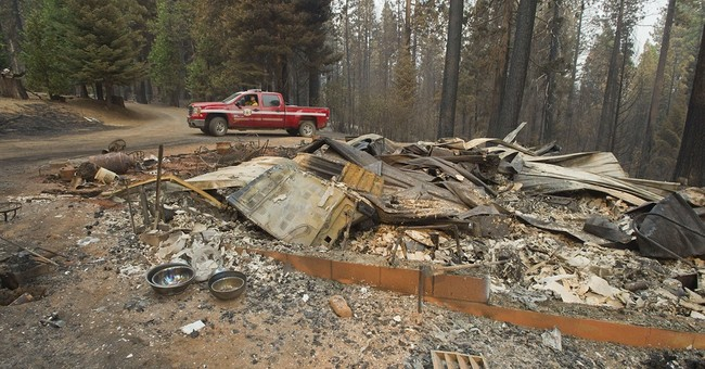 Manpower added to fight wildfire as winds expected