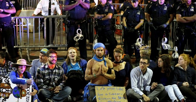 100 arrested at Wall Street climate crisis sit-in