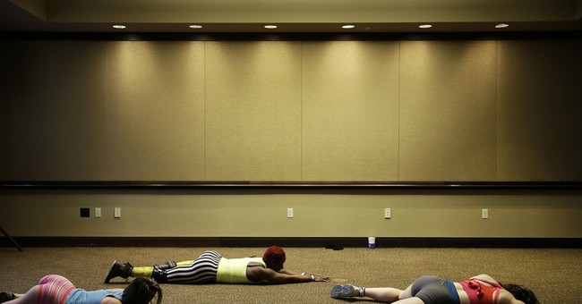 AP PHOTOS: Pole dancing being used for fitness