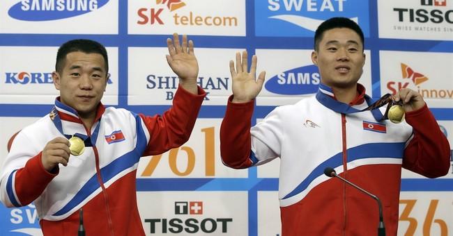 Together at Asian Games, Koreas still far apart