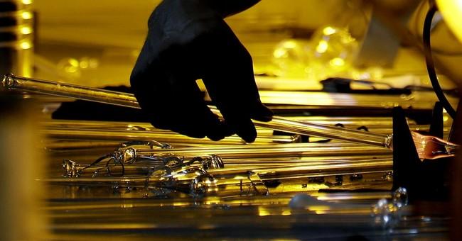 AP PHOTOS: NC artist burns glass into sculptures