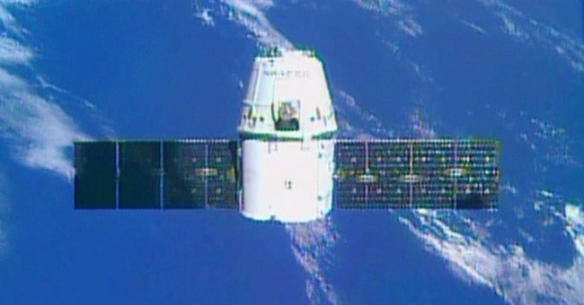 Dragon arrives at space station with 3-D printer