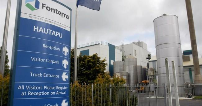 Fonterra posts revenue jump; cuts forecast payout