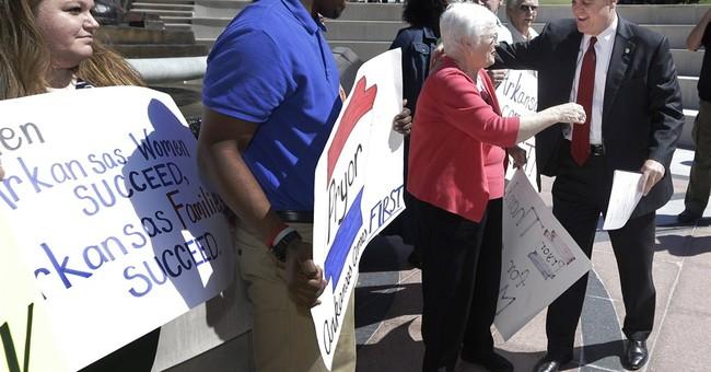 Arkansas cowers under Senate advertising barrage