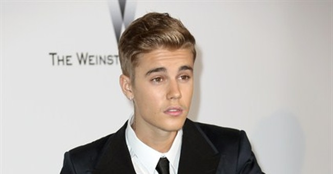 Anti-paparazzi charges revived over Bieber chase