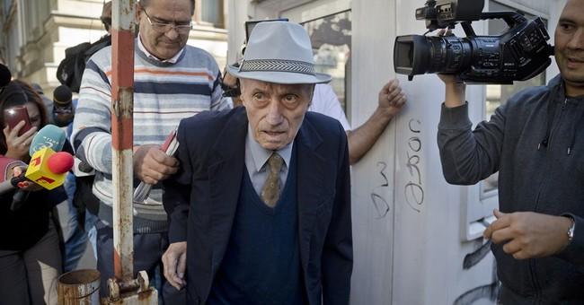 Romania puts ex-communist prison chief on trial