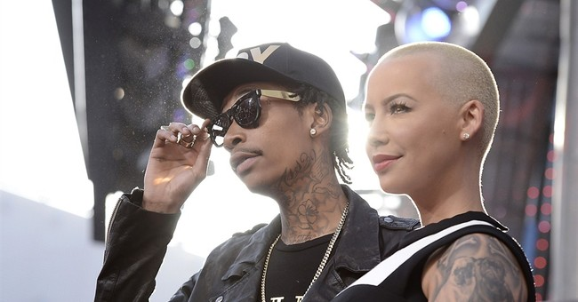 Wiz Khalifa's wife files to end marriage to rapper