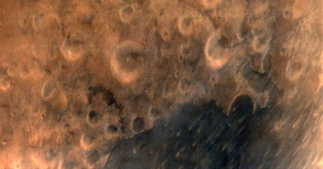India releases first image of crater-scarred Mars