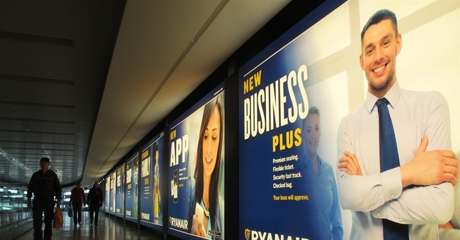 Ryanair shares rise as airline raises outlook