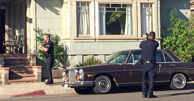 LA woman evades intruder by climbing onto roof