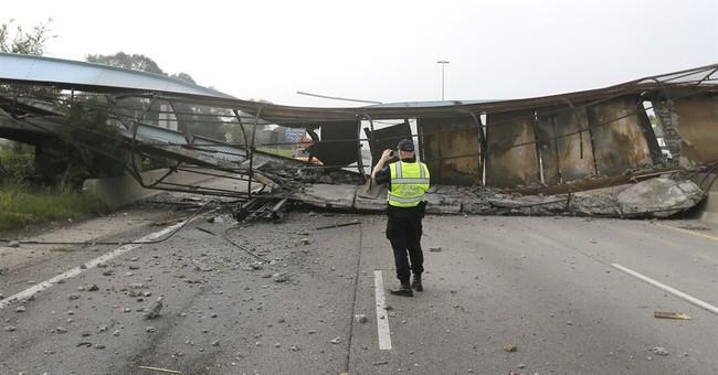 Bridge struck by trash truck collapses in Detroit
