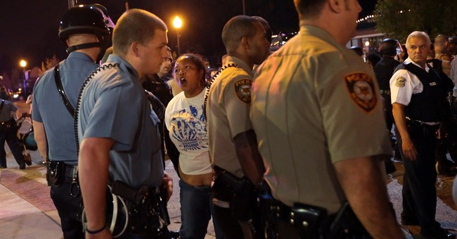 Police, protesters scuffle after Ferguson apology