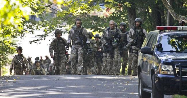 Survivalist still on run 15 days after cop's death