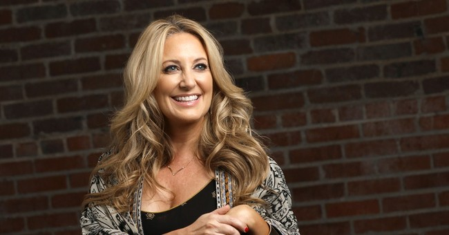 Lee Ann Womack chasing happiness over hits