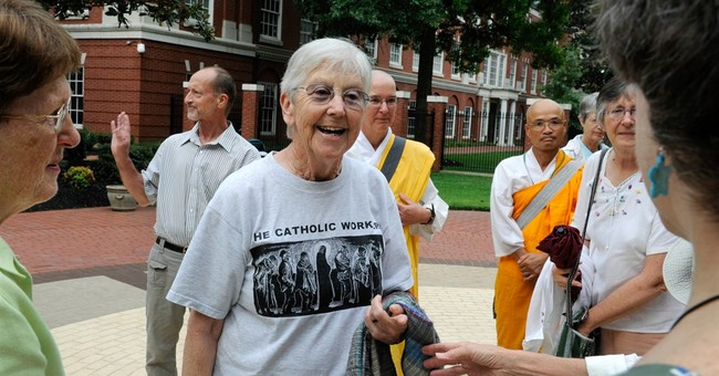 Judge orders activists to pay full restitution