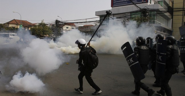 Cambodian police break up protest for TV license