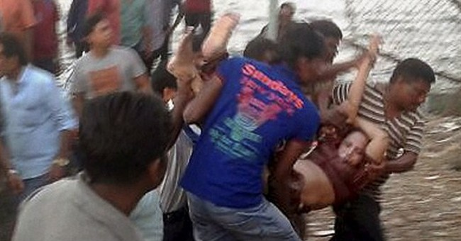 Overcrowded Indian boat may have hit rock; 21 dead