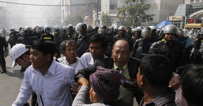 Cambodian police break up protest for TV license