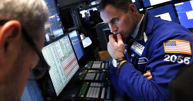 Stocks turn higher on Wall Street, Caterpillar up