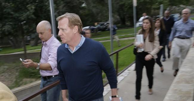 NFL commissioner visits domestic violence hotline