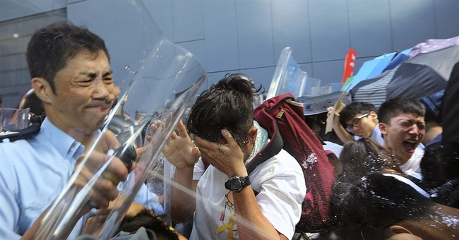 HK students scuffle with police in chaotic protest