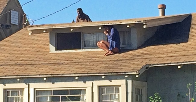 Man accused of following woman on roof is charged