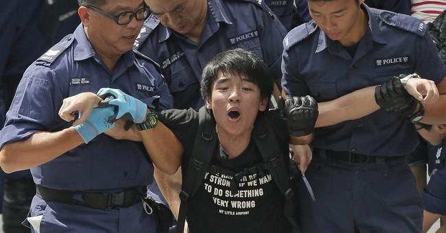HK activists start bigger protest amid standoff